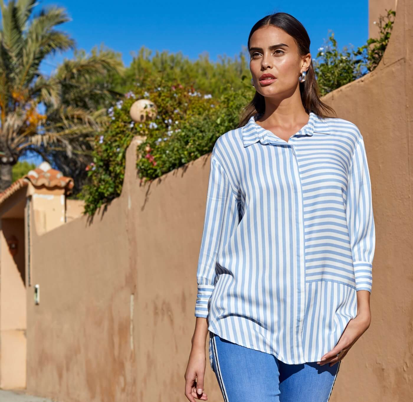 Women in Striped Shirt | The Mustcard