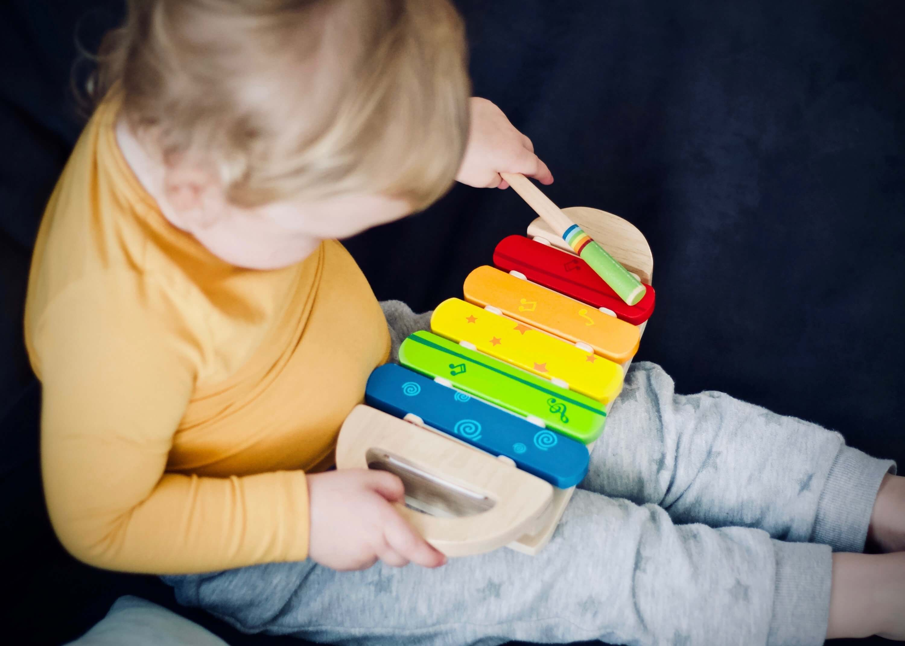 Child Playing Instrument | The Mustcard