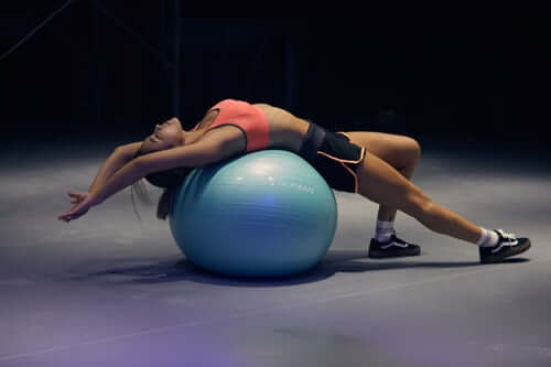 Bending on Yoga Ball | The Mustcard