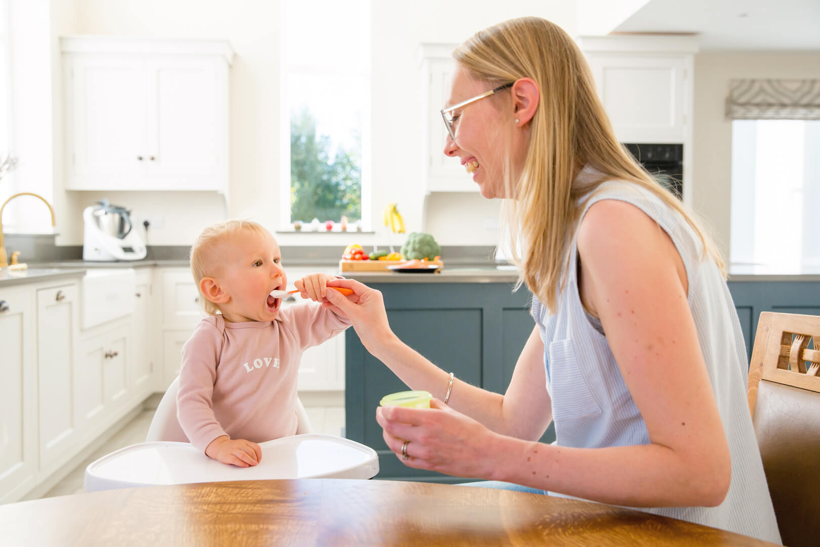Mother Feeding Baby | The Mustcard