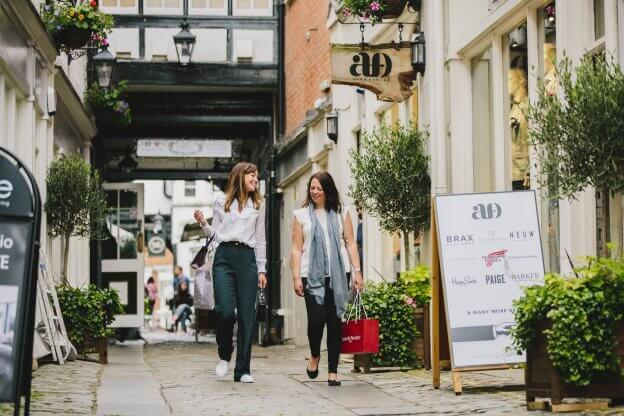 2 Friends Walking Down High Street | The Mustcard