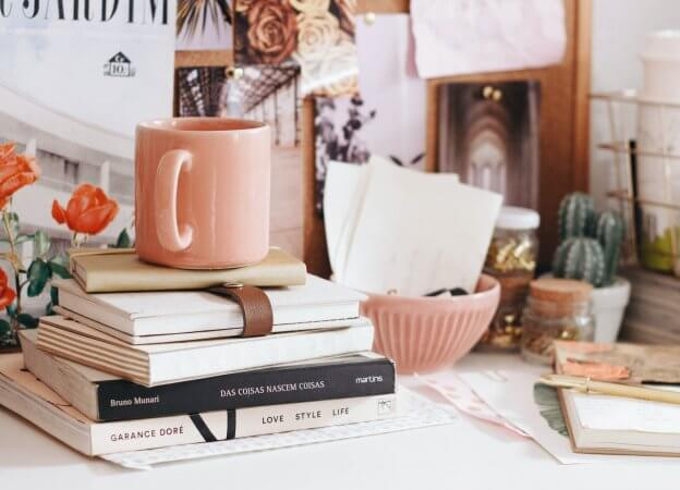 Books & Cup on Desk | The Mustcard