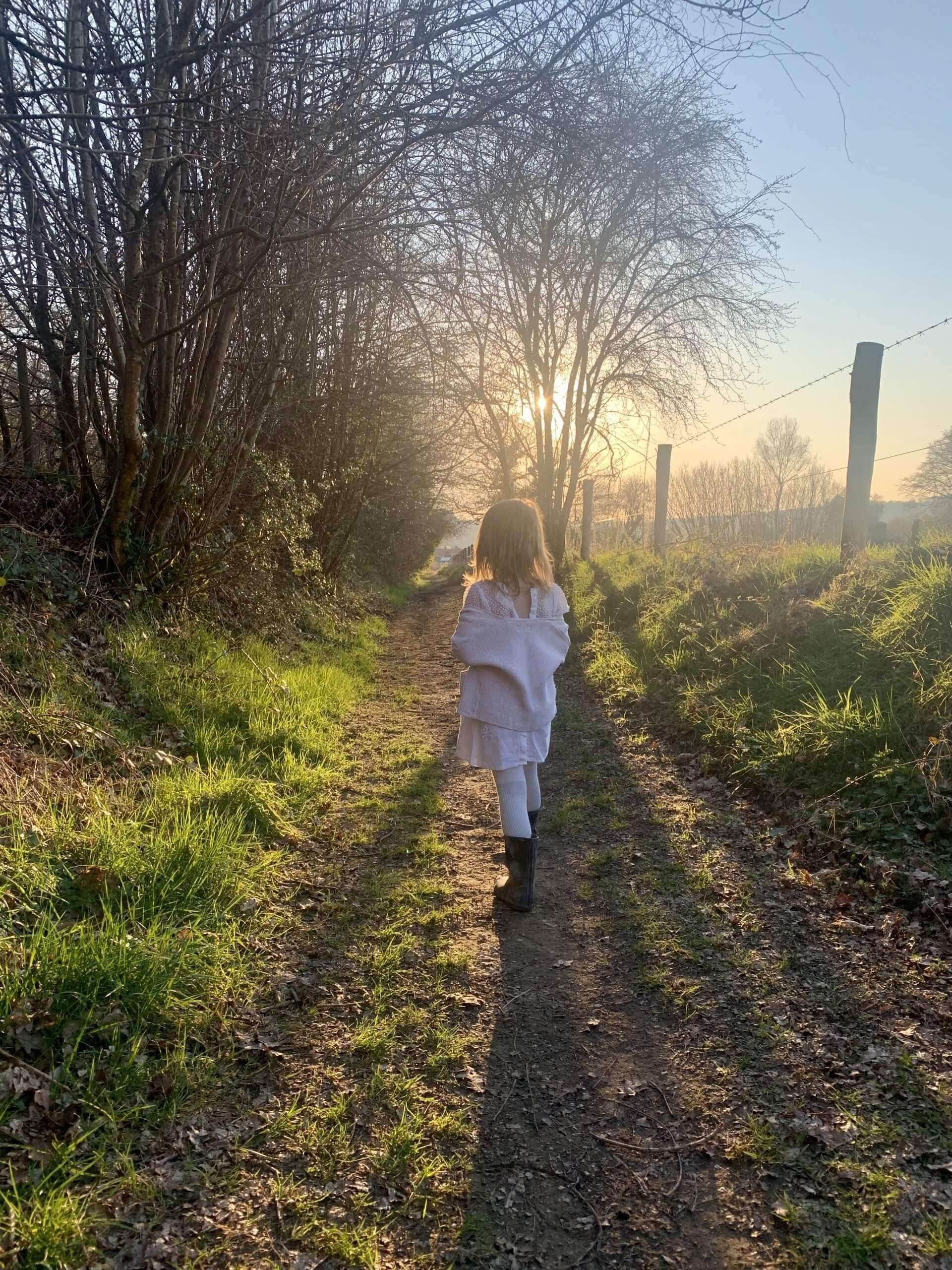 Child Walking in Fields | The Mustcard